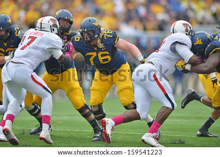 OCTOBER 19 - MORGANTOWN, WV: WVU center Pat Eger (76) looks to make a block on a run play during the Big 12 football game October 19, 2013 in Morgantown, WV.  - stock photo
