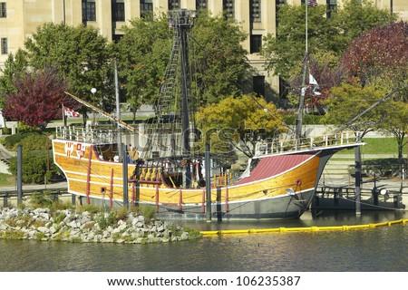 OCTOBER 2004 - Replica of Columbus' ship the Santa Maria on Scioto River, Columbus Ohio skyline in autumn - stock photo