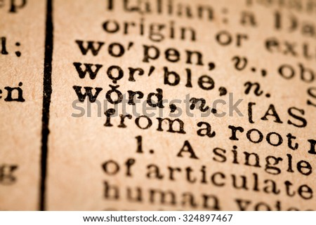 October 1st, 2015 - Montreal, Canada. Close-up of an Old 1945 Webster Vintage Dictionary showing the Word WORD - stock photo