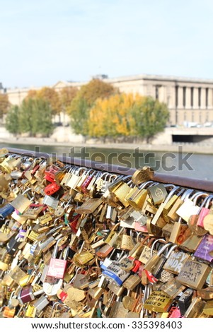 OCTOBER 27th 2015 PARIS FRANCE. The notorious 'love locks' of Paris are now covering the Pont Neuf  after over 45 tonnes of locks were removed from Pont des Artes  - stock photo