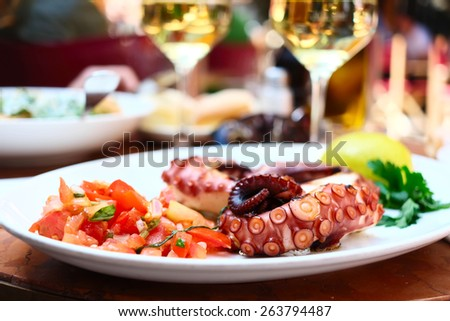 Octopus salad close up. Shallow depth of field.  - stock photo