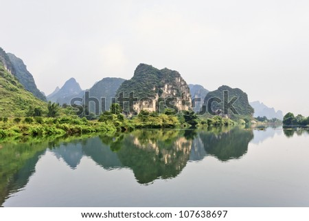 Oddly shaped Karst mountains reflected in water in Yangshuo, Guangxi Province, China - stock photo