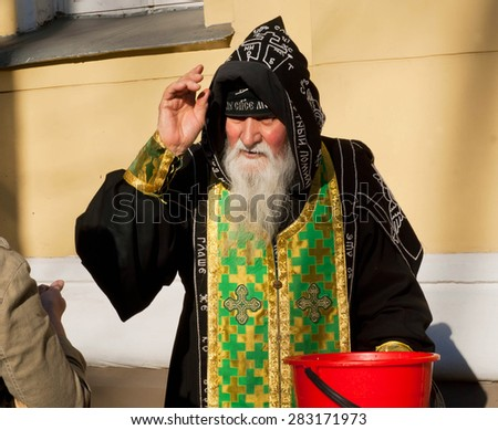 ODESSA, UKRAINE - APR 14: Orthodox monk hood blesses people outside the monastery on April 14, 2015. With a population of 1,003,705, Odessa is multiethnic cultural center and major seaport of Ukraine - stock photo