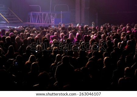 Odessa, Ukraine, April 17 2012: Pop concert iconic Russian singer Philip Kirkorov in Odessa. Bright colorful light and theatrical show with the full house. - stock photo