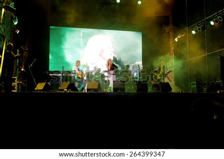 Odessa, Ukraine - August 25, 2011: Crowd Published on outdoor rock concert at night, during creative light and music show fashionable jazz orchestra. The audience raised their hands in delight and fun - stock photo