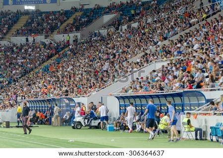 ODESSA, UKRAINE - 14 August, 2015: Football fans and spectators in  stands of the stadium emotionally support their team during  game of FC Shakhtar (Donetsk) - Dnipro (Dnipropetrovsk).  Ukrainian Cup - stock photo