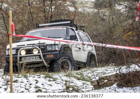 Odessa, Ukraine - December 6, 2014: Off-road 4x4 cars on the road passes sport routes in the winter mountains close-up, December 6, 2014 in Odessa, Ukraine. - stock photo
