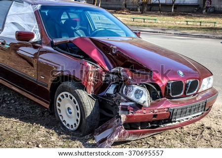 Odessa, Ukraine - February 19, 2015: Red Car Crash. The driver at high speed lost control after hitting a hole in the road. Bad road. - stock photo