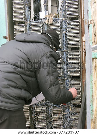 Odessa, Ukraine, February 12, 2016 -: The telephone repair telecommunications distribution panel. Using vintage telephone rotary dial, it checks the loop for analog phones. - stock photo