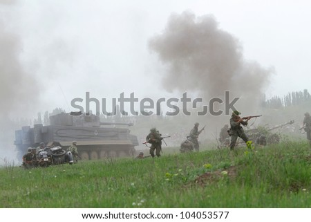 """ODESSA, UKRAINE - MAY 6. The """"Odessa historical military club"""" demonstrates for public historical reconstruction of combat between Soviet and German armies during World War 2 on May 6, 2012 in Odessa - stock photo"""
