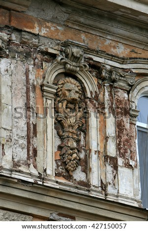 ODESSA, UKRAINE - May 23, 2016: The ruined facade of a historic building. Destroyed monuments. Old facade. Architectural detail of the damage to the outside of the castle facade. Historic ruins - stock photo