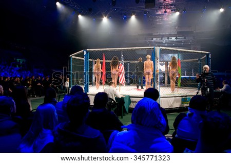 Odessa, Ukraine - November 24: Fight Octagon in the final competition MMA. Fighters come to compete in the cell, resulting in punching, kicking and wrestling. November 24, 2015 in Odessa, Ukraine - stock photo