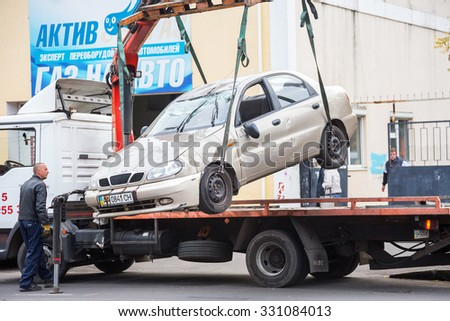 ODESSA, UKRAINE - OCTOBER 24, 2015: car hauler picks up after a car accident October 24, 2015 in Odessa, Ukraine - stock photo