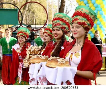 Odessa, Ukraine - October 27, 2013: The traditional national ritual meets the road for important guests with bread and salt in national dress October 27, 2013 in Odessa, Ukraine. - stock photo