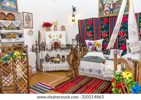 Odessa, Ukraine - September 24, 2015: Former interior exposition historical museum of ancient Ukrainian culture. The interior in the style of the agricultural Cossacks. Vintage kitchen utensils. - stock photo