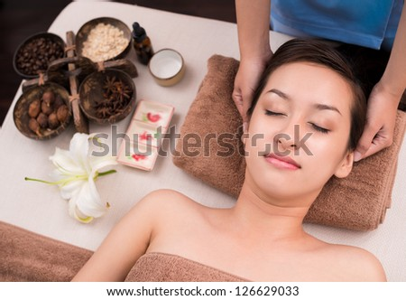 of a woman's face in spa salon - stock photo