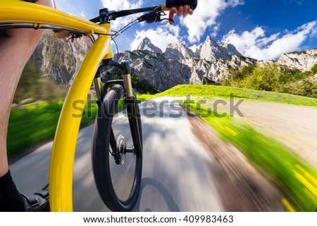 of fast dynamic bicycle with mountain landscape - stock photo