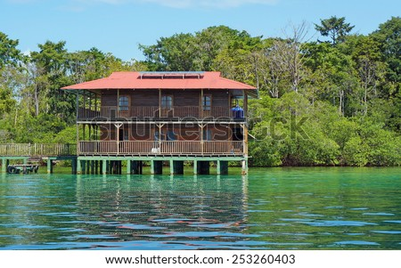 Off grid Caribbean house over water and solar powered, Panama, Central America - stock photo
