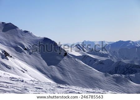 Off-piste slope and snowy mountains in morning. Georgia, ski resort Gudauri. Caucasus Mountains. - stock photo