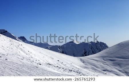 Off-piste slope at nice sunny day. Georgia, ski resort Gudauri. Caucasus Mountains. - stock photo