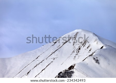 Off-piste snowy slope in morning. Caucasus Mountains, Georgia, ski resort Gudauri. - stock photo