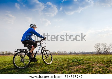 Off road Racing Cyclist - stock photo
