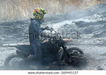 Off-road rider  against a steaming ground   Nakhodka Russia 04.12.2015 - stock photo