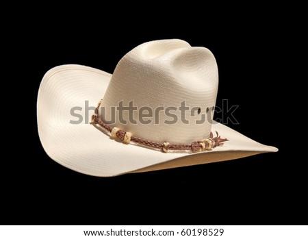 Off white cowboy hat on black, slanted - stock photo