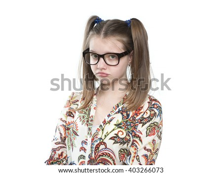 Offended teen girl. Studio photography on a white background. Age of child 11 years. - stock photo