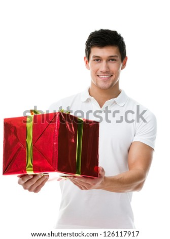 Offering a present wrapped in red paper sporty man, isolated on white - stock photo