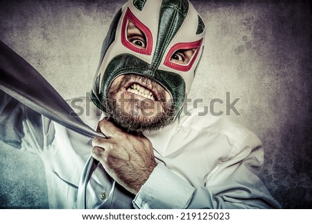 Office, aggressive executive suit and tie, Mexican wrestler mask - stock photo