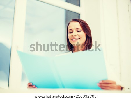 office and business concept - smiling attractive businesswoman with folder in office - stock photo