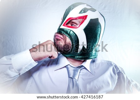Office, angry businessman with Mexican wrestler mask, expressions of anger and rage - stock photo