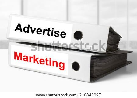 office binders advertise marketing - stock photo
