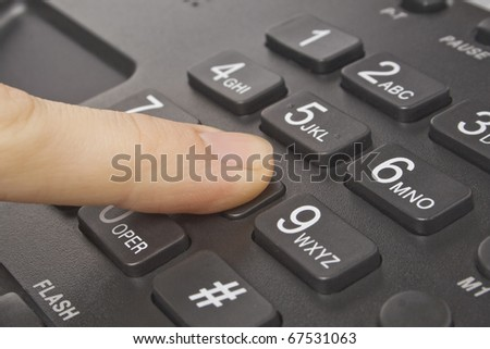 office black telephone with hand isolated on white - stock photo