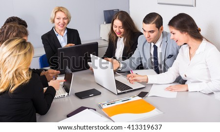 Office brainstorming of professional business team at meeting in agency - stock photo