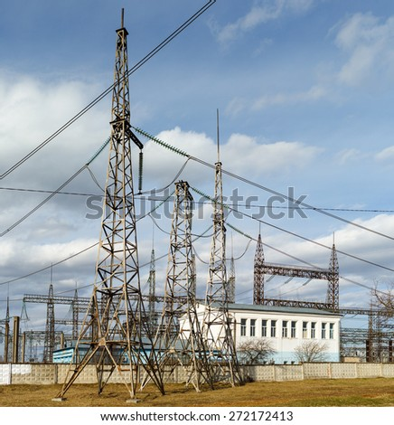 office building electricity power plant  and pylons - stock photo