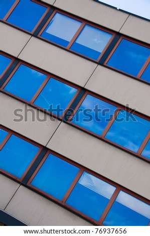 Office building on a background of sky and clouds. - stock photo