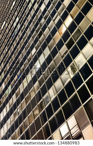 Office building's curtain wall at night, shot from an extreme low and wide angle. Good for backgrounds. - stock photo