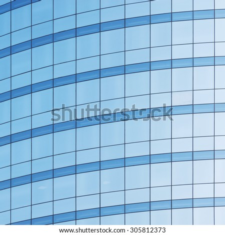 Office building wall in the business city center at sunset time. - stock photo