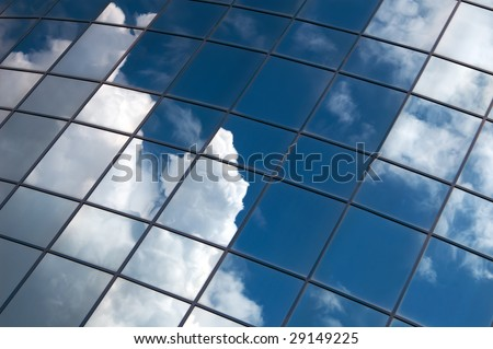 office building windows with clouds mirror - stock photo