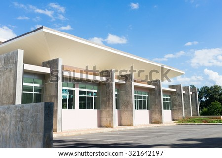 office building with parking lot - stock photo