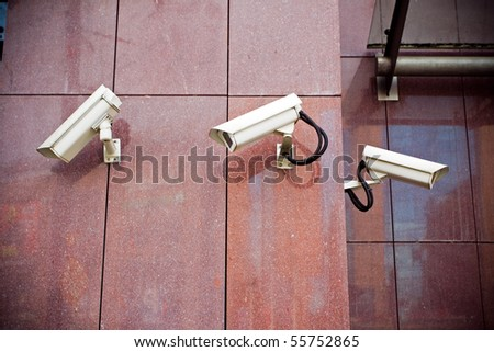 Office building with security cameras watching around - stock photo