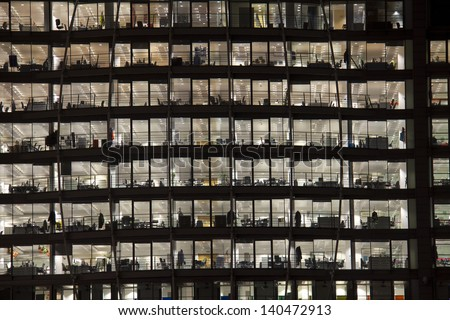 Office building with the lights on in London, UK - stock photo