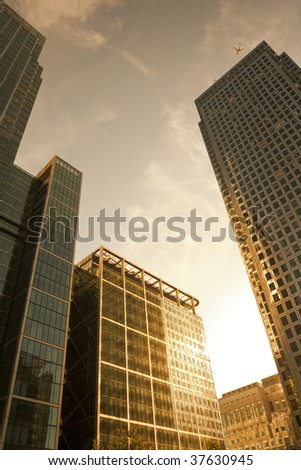 Office buildings in Canary Wharf, London before sunset - stock photo