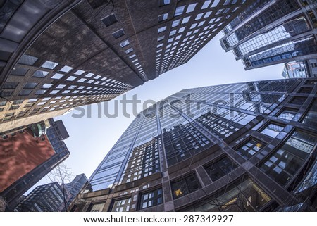 Office buildings in Toronto Ontario Canada appear to be falling towards each other. Photo taken with a fisheye lens. - stock photo