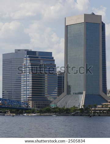 Office buildings on the river - stock photo