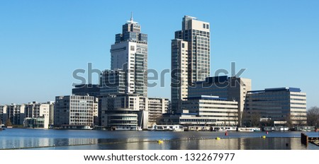 Office buildings. Panoramic view of the tallest skyscrapers of Amsterdam, Netherlands. - stock photo