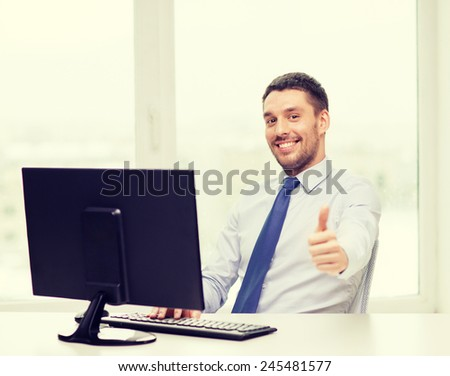 office, business, education, technology and internet concept - smiling businessman or student with computer showing thumbs up gesture - stock photo