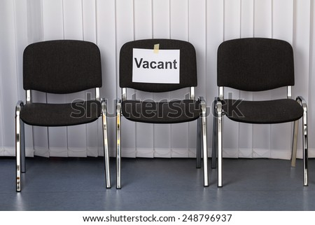 Office Chair With A Vacant Sign At Work Place - stock photo